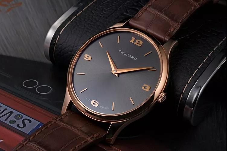 The rose gold hands and hour markers are in contrast to the dark gray dial.