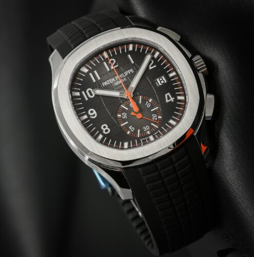 The orange elements on the dial are striking to the black background.