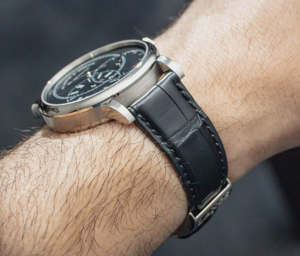 The male copy watches have black straps.